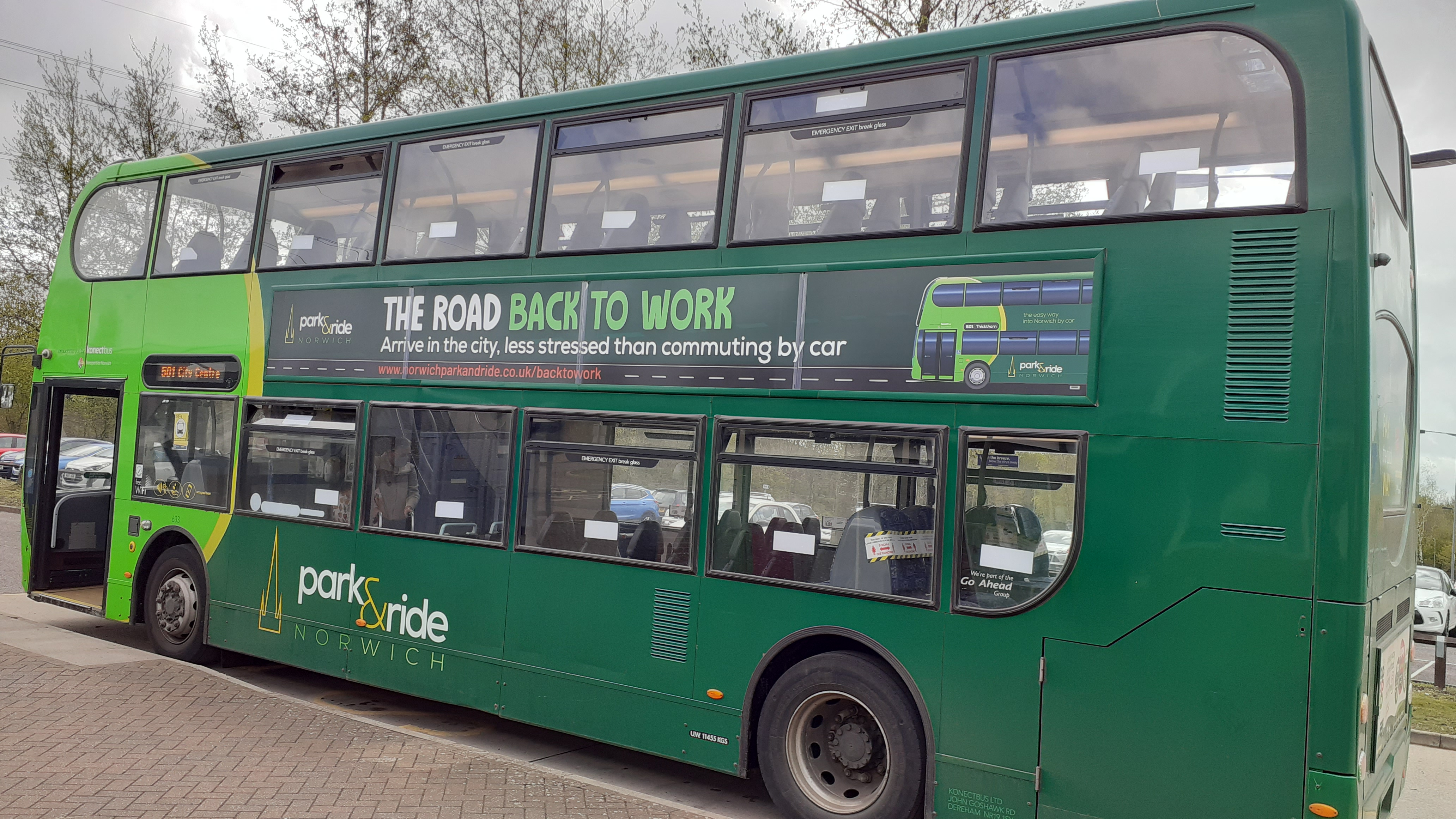 Image of a Park and Ride bus with advertising
