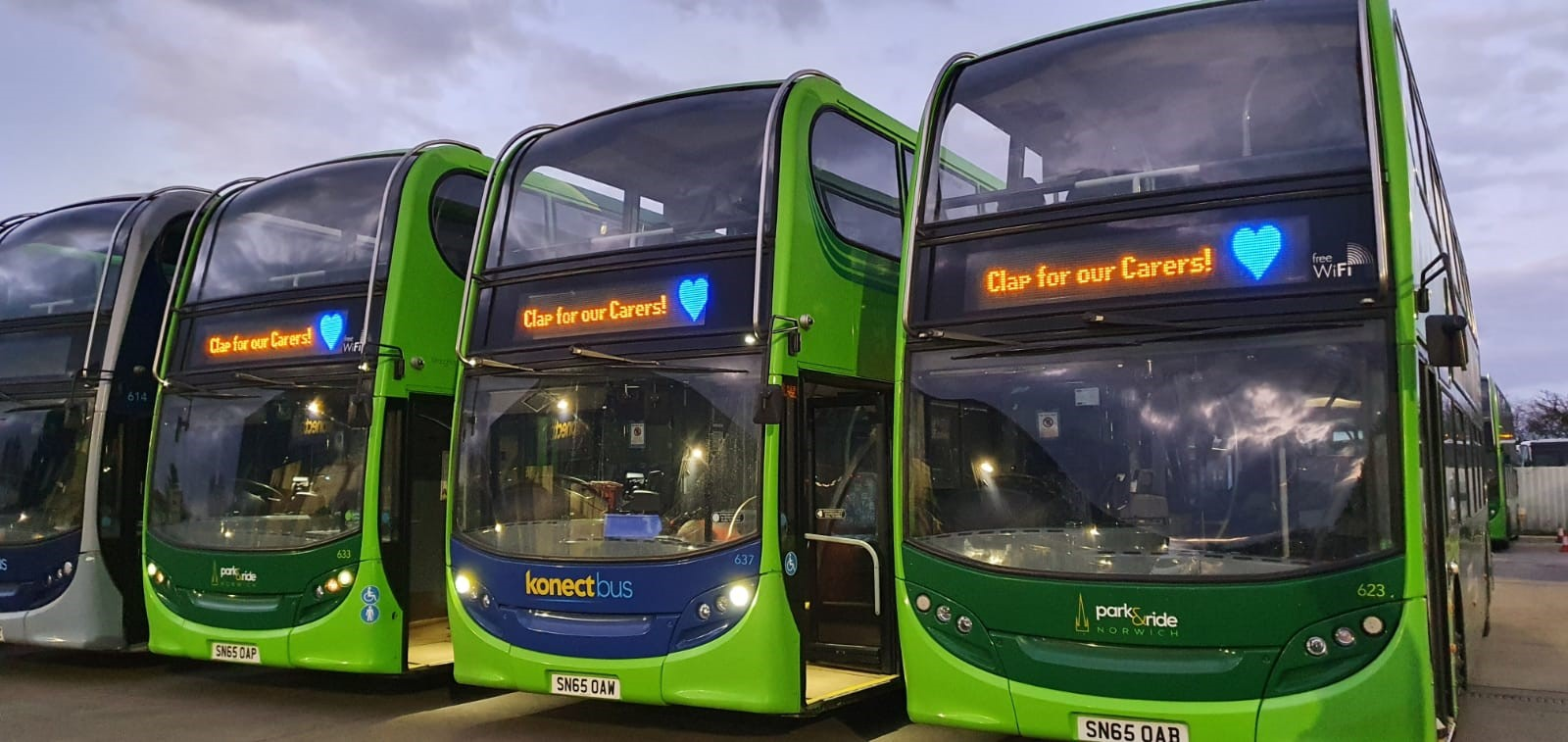 Photo of 3 Konectbus vehicles showing Clap for Carers on the front
