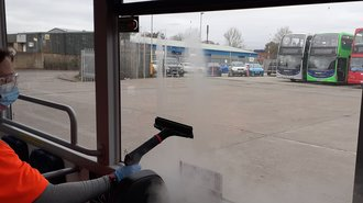 Photo of steam cleaning a bus